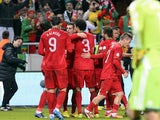 Portugal's Cristiano Ronaldo celebrates with teammates after scoring his team's third goal against Sweden during their World Cup play-off match on November 19, 2013