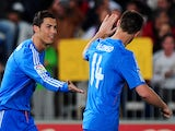 Real Madrid's Portuguese forward Cristiano Ronaldo celebrates with his teammate midfielder Xabi Alonso after scoring during the Spanish league football match against UD Almeria on November 23, 2013