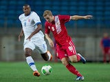 Daniel Duarte of Gibraltar competes for the ball with Karim Guede of Slovakia during an international friendly match on November 19, 2013