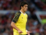 Sevilla's Diego Perotti in action during a friendly match against Manchester United on August 9, 2013