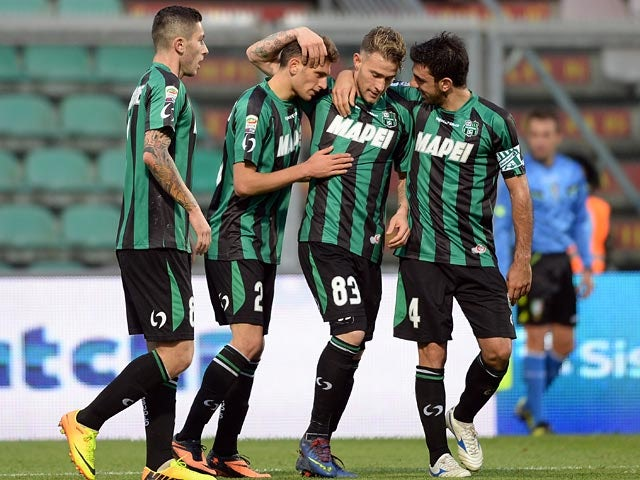 Sassuolo's Domenico Berardi is congratulated by teammates after scoring his team's second goal against Atalanta on November 24, 2013