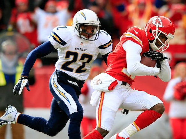 Wide receiver Donnie Avery of the Kansas City Chiefs makes a catch and runs in for a touchdown as cornerback Derek Cox of the San Diego Chargers on November 24, 2013