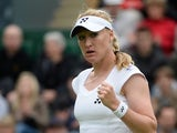 Elena Baltacha of Great Britain reacts during the Ladies Singles match against Flavia Pennetta of Italy on day one of the Wimbledon Lawn Tennis Championships at the All England Lawn Tennis and Croquet Club on June 24, 2013