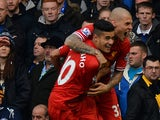 Liverpool's Brazilian midfielder Philippe Coutinho celebrates scoring a goal during the English Premier League football match between Everton and Liverpool at Goodison park in Liverpool on November 23, 2013