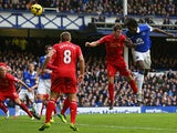 Romelu Lukaku of Everton scores his team's third goal during the Barclays Premier League match between Everton and Liverpool at Goodison Park on November 23, 2013