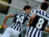 Juventus' Fernando Llorente celebrates after scoring the opening goal against Livorno during their Serie A match on November 24, 2013