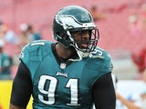 Defensive end Fletcher Cox #91 of the Philadelphia Eagles warms up for play against the Tampa Bay Buccaneers October 13, 2013
