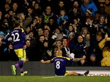 Jonjo Shelvey #8 of Swansea celebrates scoring his team's second goal with Angel Rangel during the Barclays Premier League match between Fulham and Swansea City at Craven Cottage on November 23, 2013