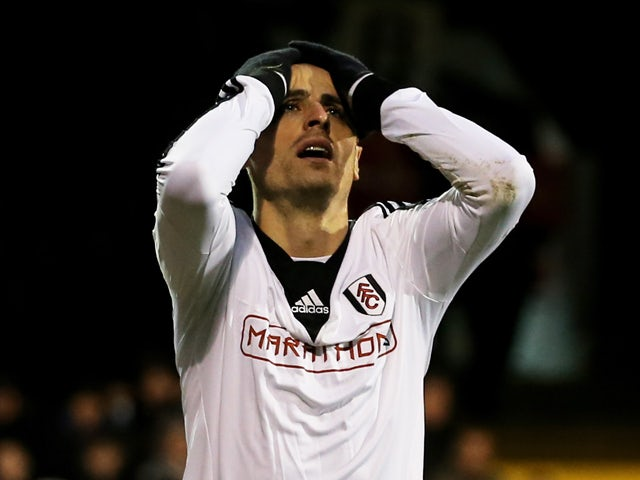 Dimitar Berbatov of Fulham reacts after a missed chance on goal during the Barclays Premier League match between Fulham and Swansea City at Craven Cottage on November 23, 2013