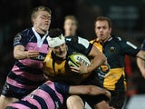 Glenn Dickson of Northampton Saints tackled by Ollie Thorley and Charlie Sharples of Gloucester during the LV= Cup match between Northampton Saints and Gloucester at Franklin's Gardens on November 9, 2013