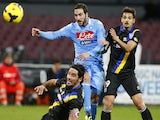 Napoli's Gonzalo Higuain fights for the ball with Parma's Jonathan Biabiany and Felipe during the Serie A football on November 23, 2013