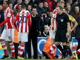 Sunderland manager Gustavo Poyet remonstrates with referee Kevin Friend during the Premier League match between Stoke City and Sunderland at Britannia Stadium on November 23, 2013