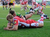 Billy Twelvetrees of Gloucester Rugby dives over to score a try despite the efforts of Luke Wallace of Harlequins during the Aviva Premiership Rugby match between Harlequins and Gloucester at Twickenham Stoop on November 23, 2013