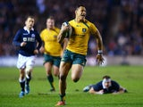 Israel Folau of Australia breaks free from Moray Low and the Scottish defence to scores a try during a game on November 23, 2013
