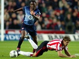 James Beattie, then of Southampton, battles for possession against Arsenal on November 23, 2002.