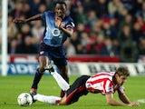 James Beattie, then of Southampton, battles for possession against Arsenal on November 23, 2002.