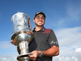 Jason Day poses with the trophy after winning the tournament in the final round of the World Cup of Golf on November 24, 2013