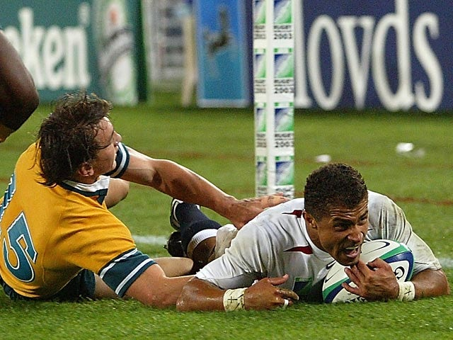 England's Jason Robinson dives over to score a try against Australia during the final of the World Cup on November 22, 2003