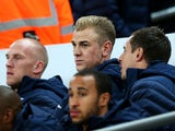 Joe Hart of England looks on fron the bench prior to the international friendly match between England and Chile at Wembley Stadium on November 15, 2013