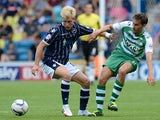 Josh Wright of Millwall contests the ball with Edward Upson of Yeovil during the Sky Bet Championship match between Millwall and Yeovil Town at The Den on August 03, 2013