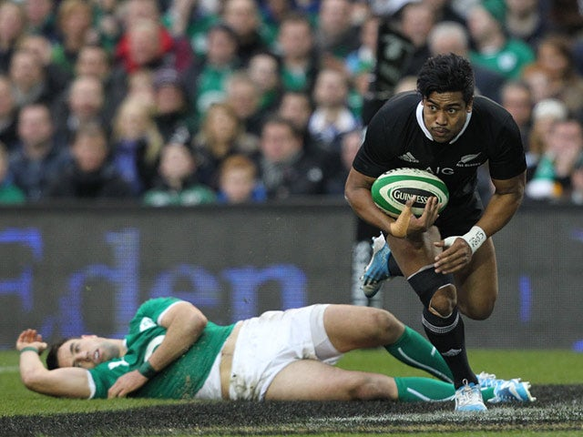 New Zealand's Julian Savea evades a tackle from Ireland's Conor Murray to score a try during their international match on November 24, 2013