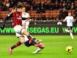 AC Milan's Brazilian forward Kaka kicks and scores during the Serie A football match between AC Milan and Genoa at San Siro Stadium in Milan on November 23, 2013