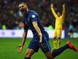 France's Karim Benzema celebrates after scoring his team's second goal against Ukraine during their World Cup play-off match on November 19, 2013