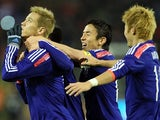 Japan's Keisuke Honda celebrates after scoring his team's second goal against Belgium during their international friendly match on November 19, 2013