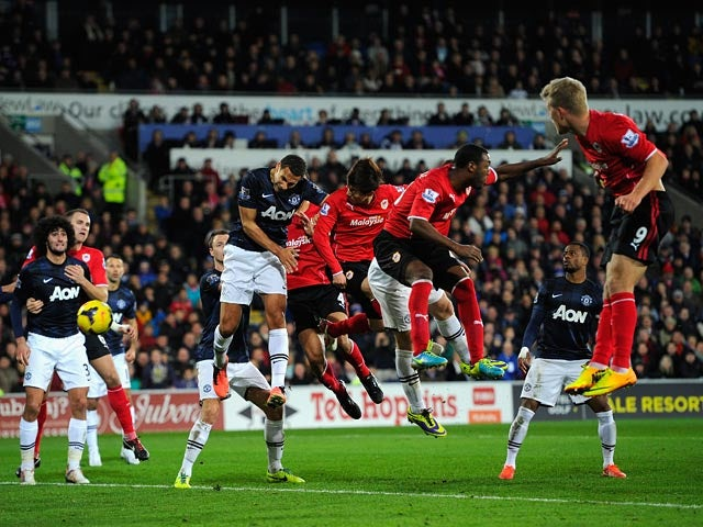 Cardiff's Kim Bo-Kyung heads in the late equaliser against Manchester United during their Premier League match on November 24, 2013