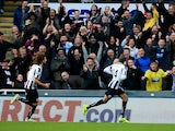 Loic Remy of Newcastle celebrates scoring the opening goal during the Barclay's Premier League match against Norwich City on November 23, 2013