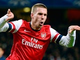 Arsenal's German striker Lukas Podolski celebrates scoring his team's second goal during the UEFA Champions League Group B football match against Montpellier on November 21, 2012