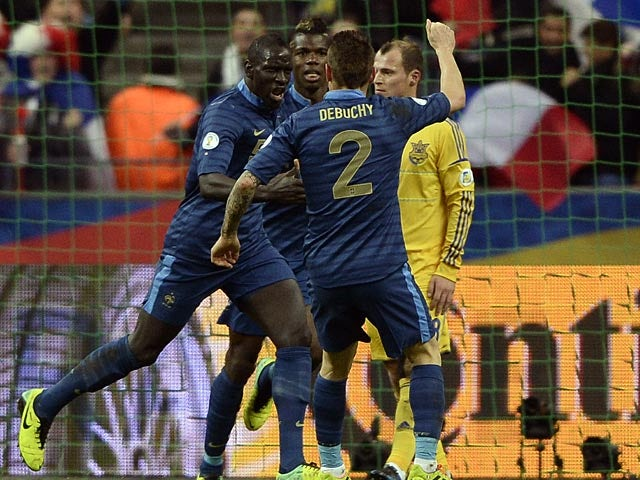 France's Mamadou Sakho celebrates with teammates after scoring the opening goal against Ukraine during their World Cup play-off match on November 19, 2013