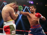 Manny Pacquiao in action against Brandon Rios during their WBO International Welterweight title bout on November 24, 2013