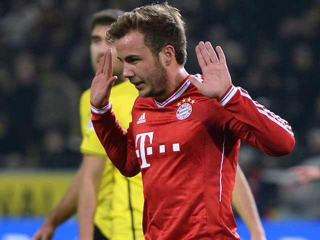 Bayern Munich's midfielder Mario Goetze refuses to celebrate after scoring the 0-1 during the German first division Bundesliga football match against his old club Borussia Dortmund on November 23, 2013