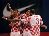 Croatia's Mario Mandzukic celebrates with teammates after scoring the opening goal against Iceland during their World Cup play off match on November 19, 2013