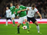 Germany's Max Kruse and England's Steven Gerrard battle for the ball during their international friendly match on November 19, 2013