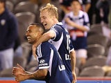 Mitchell Nichols of Victory celebrates scoring a goal with Archie Thompson of Victory during the round seven A-League match between Melbourne Victory and Adelaide United at Etihad Stadium on November 23, 2013