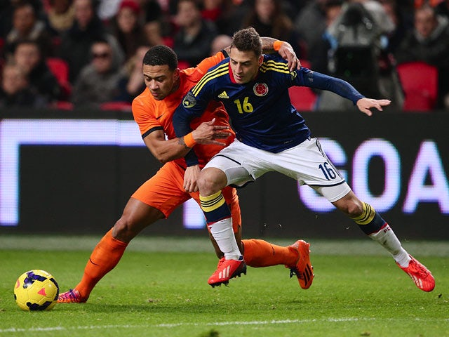 Result: Colombia held by 10-man Holland