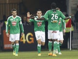 Saint-Etienne's Mevlut Erding celebrates with teammates after scoring the opening goal against Nice on November 24, 2013