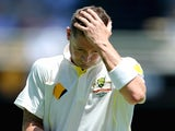 Australia captain Michael Clarke leaves the field after being dismissed by Stuart Broad of England during day one of the First Ashes Test match on November 21, 2013
