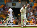 Australia 's Mitchell Johnson celebrates after dismissing England's Kevin Pietersen during day four of the First Ashes Test match on November 24, 2013