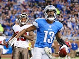 Nate Burleson of the Detroit Lions celebrates after scoring a touchdown on an 11 yard pass from quarterback Matthew Stafford during the game against the Tampa Bay Buccaneers on November 24, 2013