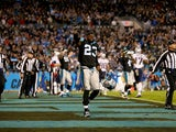 Melvin White #23 of the Carolina Panthers celebrates after the game is over against the New England Patriots at Bank of America Stadium on November 18, 2013