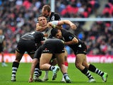 England's Sam Burgess is tackled by New Zealand's Elijah Taylor, Ben Matulino, Bryson Goodwin and Simon Mannering during the 2013 Rugby League World Cup semi-final match between England and New Zealand at Wembley Stadium in London, England on November 23,