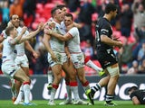 Sam Burgess of England celebrates scoring his sides third try during the Rugby League World Cup Semi Final match between New Zealand and England at Wembley Stadium on November 23, 2013