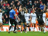 Shaun Johnson of New Zealand celebrates converting the winning try with the last kick of the game during the Rugby League World Cup Semi Final match between New Zealand and England at Wembley Stadium on November 23, 2013