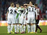 Wolfsburg's players celebrate after scoring the 0-1 during the German first division Bundesliga football match between FC Nuremberg vs VfL Wolfsburg in Nuremberg, southern Germany, on November 23, 2013