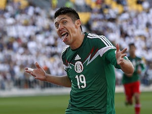 Oribe Peralta of Mexico celebrates a goal against New Zealand during their World Cup qualifying football match at Westpac Stadium in Wellington on November 20, 2013