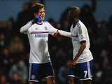 Oscar of Chelsea celebrates scoring the second goal with Ramires during the Barclays Premier League match against West Ham United on November 23, 2013
