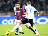 Panagiotis Kone midfielder of Bologna FC (L) fights for the ball with Argentinian midfielder Ricardo Gabriel Alvarez of Inter Milan (R) during their Serie A football match at the Renato Dall'Ara on November 24, 2013
